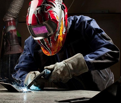 Man using a welding helmet.